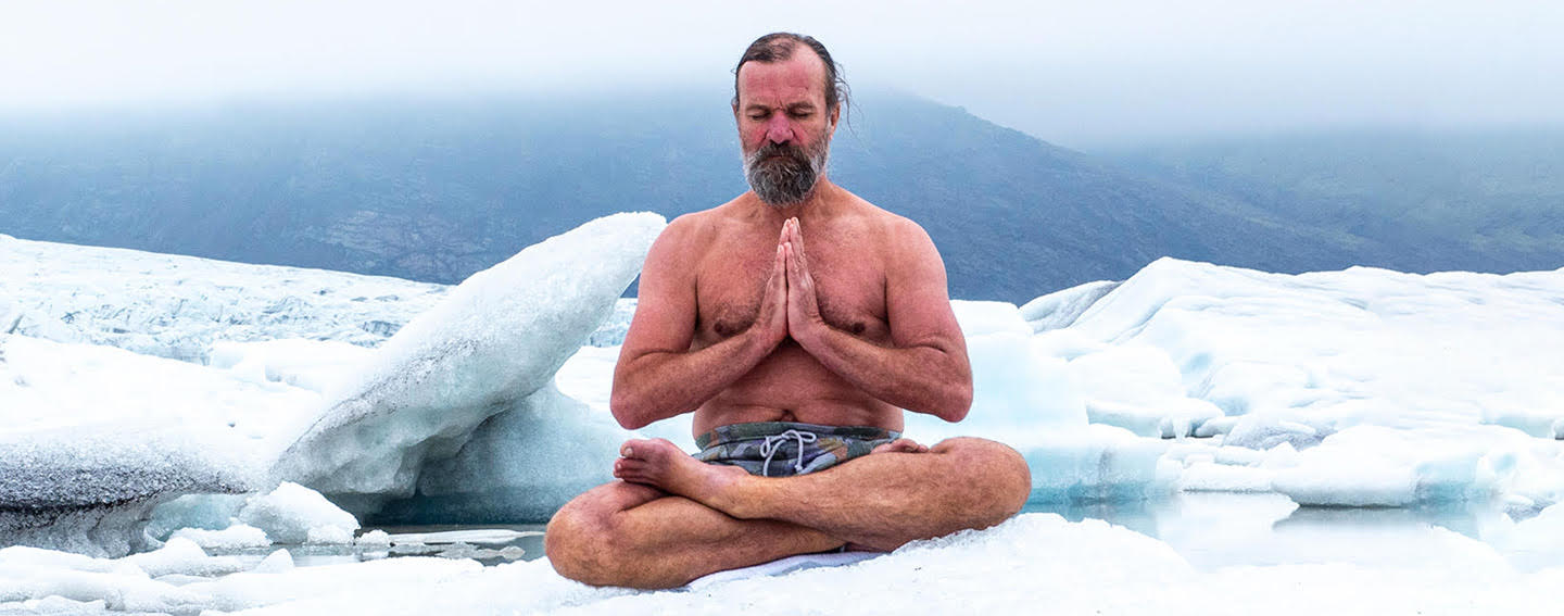 wim hof sitting in snow meditating in only shorts
